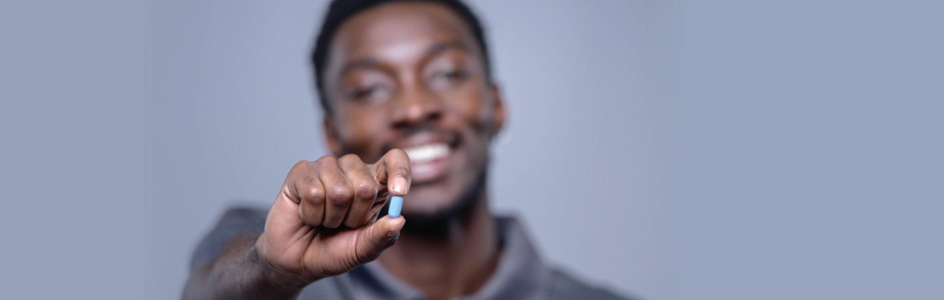 adult man holding a pill