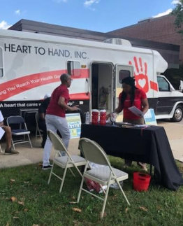 heart to hand inc laboratory truck with two staff